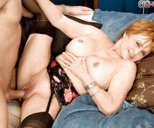 Redhead granny Valerie training a junior guy on nicer..