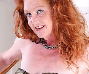 Scorching redhead granny Tami Estelle flaunts petite saggy..