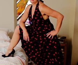 Blond granny Veronique undresses heels and subjugation..