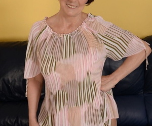Dark haired granny Margo T. gushes her fat round butt in a..