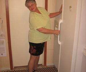 Old woman Girdle Queen strips to tights in her kitchen