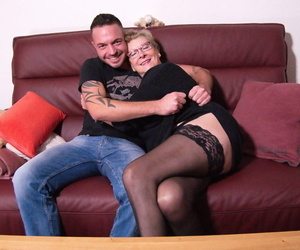 German nan has her leaned groped by toy boy while naked in..
