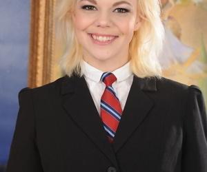 Petite blonde Alice Frost posing seductively in her school..