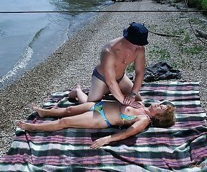 Big busted granny in bikini gives a buns and gets shagged..