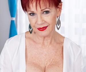 Redhead nan Caroline Hamsel glides her panties aside to..