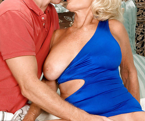 Granny with blond hair sucks ball sack and licks a fat..