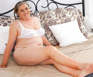Fat oma gets jizz on her hairy beaver after her junior..