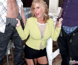Busty granny Phoenix Skye providing BJ before taking anal..