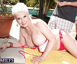 Short haired granny gives thick hard-on a deep throat and..