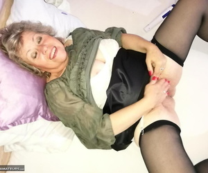 Wild grandmother Caro pleasures her hairy cunt with a..