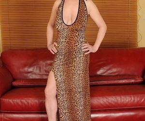 Brunette granny Babuska showcases her big tits and gets..
