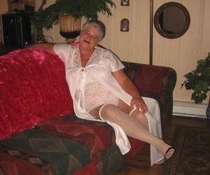 Obese granny undresses lace lingerie to model naked in OTK..