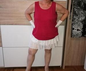 Horny nan Caro pulls down her stockings to show her bush..