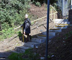Brazen molten mature granny Savana poses outdoors in her..