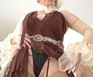Ash-blonde granny Marianne jerks before getting nailed by..