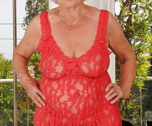 Naughty granny with enormous flabby hooters disrobing off..