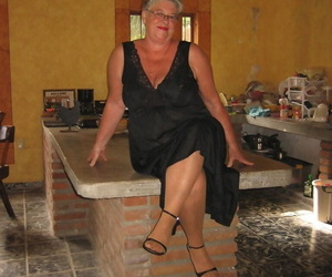 Fat oma Girdle Queen peels off to tan tights on an island..