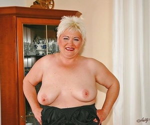 Brief haired fatty granny with flabby boobs stripping off..