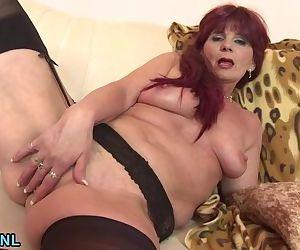 Horny granny pleasuring herself