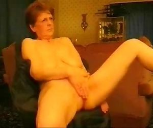 Hot granny rubbing her pussy. Amateur older - 1 min 37 sec