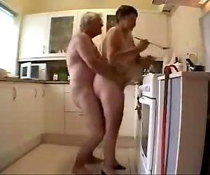 Old grand parents having fun in the kitchen. Amateur - 31 sec
