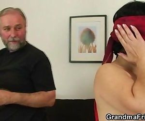 Young guy helps mature couple to fuck