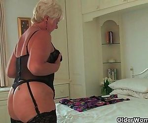 British grandma Sandie in stockings rubs her pierced clit - 6 min HD