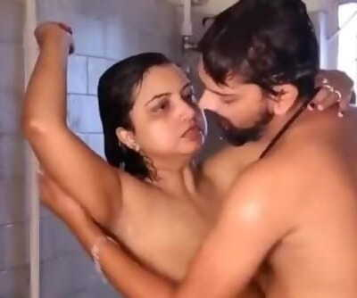 Desi milf enjoy to hard fuck in bathroom..By her neighbor youthful boy