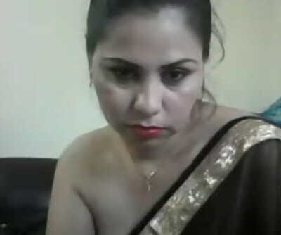 hot desi chick on cam showing boobs and teasing in a saree with hindi audio.