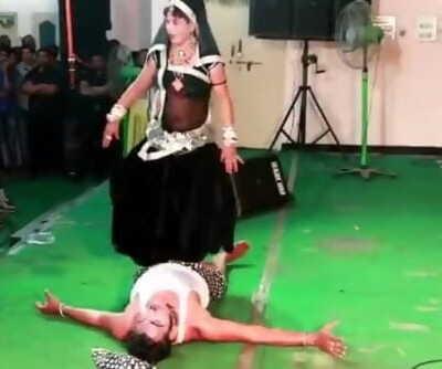 Indian Lady Trampling Man in Dance in Public