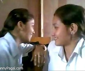 Two Indian School Girl Kissing In..