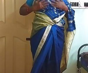 desi north indian horny cheating wife vanitha wearing blue colour saree showing big boobs and shaved pussy press hard..