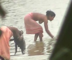 Indian women bathing by the river - 3 min