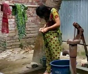 desi girl bathing outdoor for more visit http://sh.st/3b8dG - 2 min