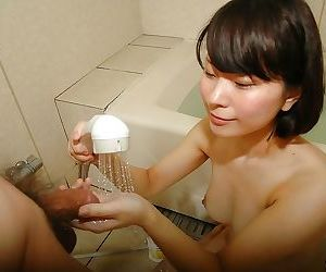 Lovely asian teen gives a wet hand and blowjob in the bathroom