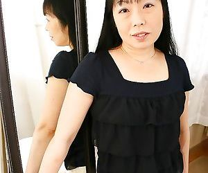 Sassy asian MILF Fumiko Manaka undressing and showcasing her shaggy twat