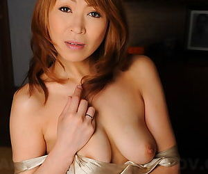 Lovely Japanese MILF Jun Kusanagi gets her soaking wet pussy fingered