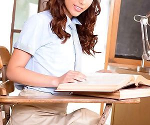 Schoolgirl Melody Wylde masturbates atop her teachers desk