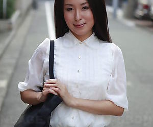 Japanese schoolgirl Anna Sakura pauses in the street to flaunt her hot beauty