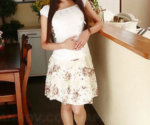 Japanese sweetie Shiho Miyasaki lifts her skirt up and displays pink snatch