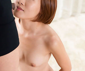 Nude Asian female sucks a cock on her knees prior to a facial cumshot