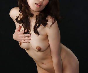 Naked Japanese chick chokes on sperm while blowing two cocks at once