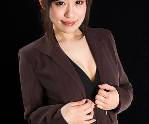 Japanese woman in suit slowly strips to the toes to give a hot footjob