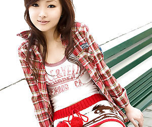 Asian teen babe Suzuka Ishikawa uncovering her petite tits and sexy ass