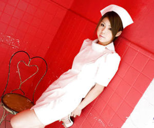 Busty asian nurse Haruka Sanada taking off her uniform and lacy panties