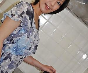 Pretty asian MILF Mayumi Iihara undressing and masturbating her cunt