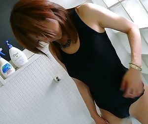 Japanese chick Yuu Mizuki wets her beaver while wearing a black bodysuit