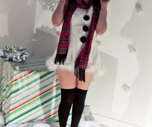 Hot redhead Japanese Sydney Mai in Christmas costume flashing naked upskirt