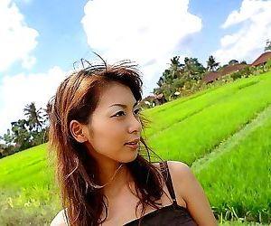 Japanese cutie honoka poses outdoors shows titties - part 2047