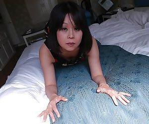 Naughty asian MILF Yukari Yamagishi getting naked and playing with a vibrator